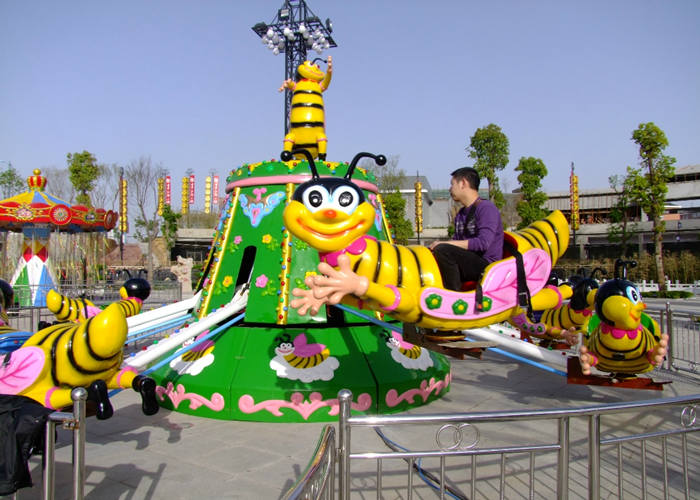 Going On A Bumble Bee Ride At A Carnival - Premium Amusement