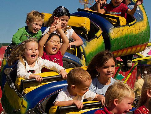 Going On A Kids Roller Coaster At The Fair
