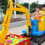Why Kids Love The Excavator Ride At The Amusement Park